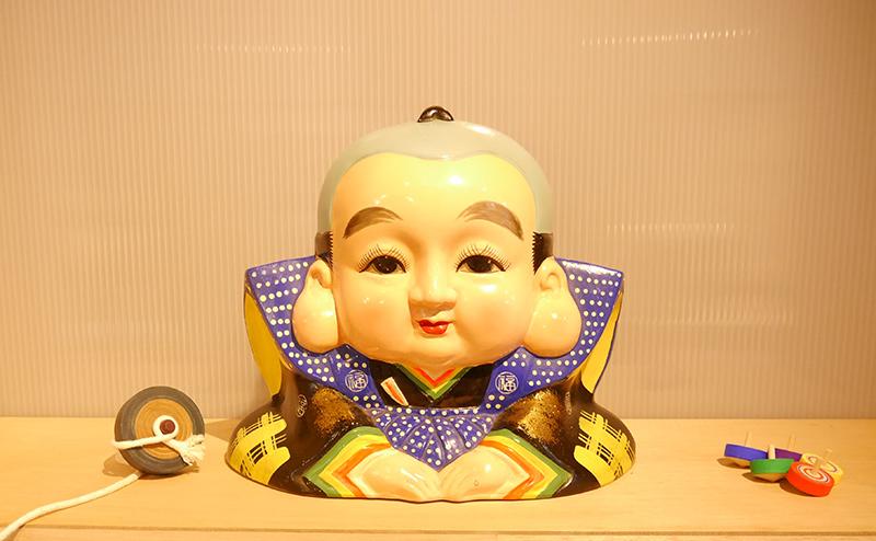 小松屋製菓のシンボル「福助くん」